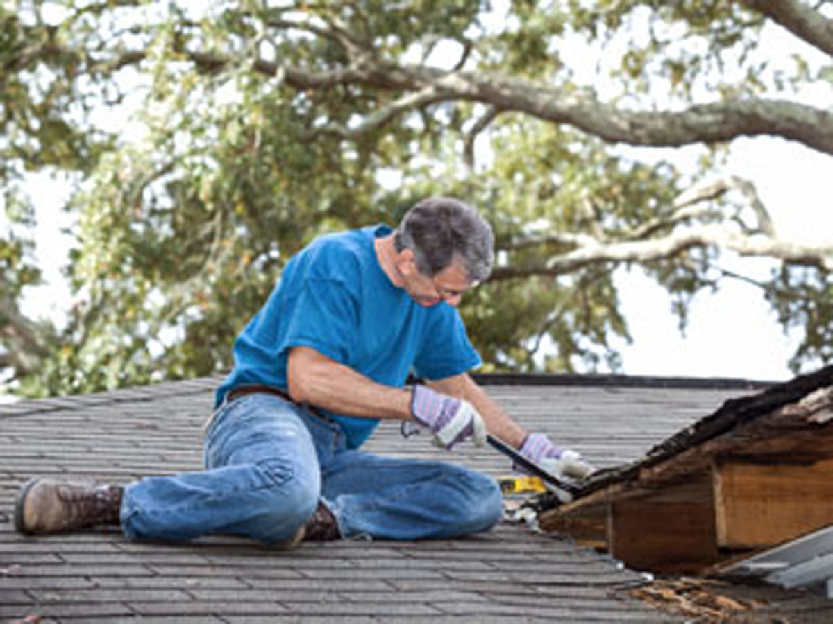 Man Repairing Leaking Roof Southpaw Roofing